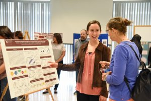 A student presents at the WSU Tri-CIties Undergraduate Research Symposium and Art Exhibition in spring 2017