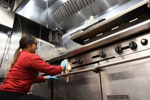 A student in a WSU Tri-Cities psychology statistics course volunteers her time to clean the kitchen at the Tri City Union Gospel Mission in Pasco