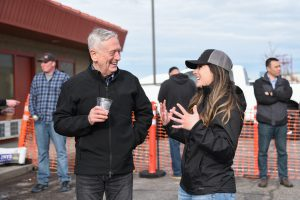 WSU Tri-Cities student veteran Bernie Gagnier chats with former U.S. Secretary of Defense James Mattis during the GIPA release party at Bombing Range Brewing Company