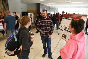 Students present during the WSU Tri-Cities Undergraduate Research Symposium and Art Exhibition