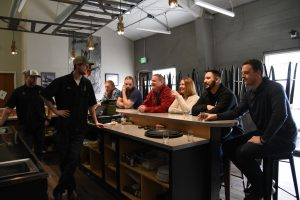 WSU Tri-Cities student veterans chat with Bombing Range Brewing Company owners while tasting a selection of their beers