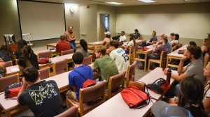 Entomology professor Allan Felsot speaks to a group of students during a fall new student orientation