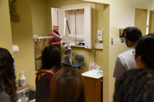 Grace Clinic CEO Mark Brault takes WSU Tri-Cities students on a tour of the clinic