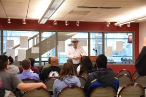 Geoff Schramm presents during first-generation student celebration event