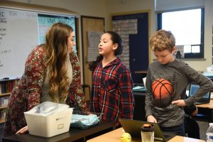 McKenzie Munn speaks with students at Marcus Whitman Elementary School