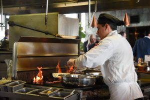 A chef cooks an entry that was served as part of the Point to Success Brunch at Anthony's at Columbia Point in Richland
