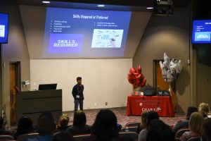 A student presents during a GEAR UP Career Night at WSU Tri-Cities
