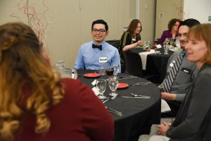 WSU Tri-Cities student Lian Jacquez chats with professionals during the Career Development Etiquette Dinner at WSU Tri-Cities
