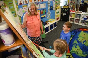 WSU Tri-Cities education alumna Becky Rausch works with kindergarten students at Sacajawea Elementary School in Richland