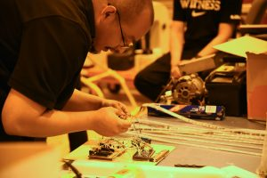 Engineering student David Garcia works on electrical components of the Willow of the Waste project