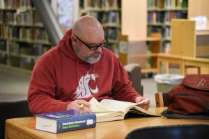 Geoff Schramm studying in the library at WSU Tri-Cities