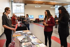 Maria Fernanda Vargas (right) talks with students and staff about international programming during a Preview Day for prospective students at WSU Tri-Cities