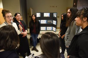 Student present their psychology project during an Undergraduate Research Symposium and Art Exhibition at WSU Tri-Cities.