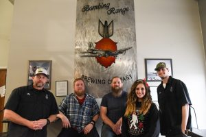 WSU Tri-Cities student veterans pose for a photo with Bombing Range Brewery owners at their location in Richland