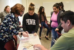 WSU Tri-Cities education adjunct professor Cathie Tate works with students in an education course