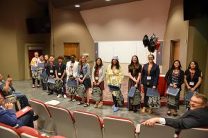 GEAR UP Eighth-Grade Career Showcase Participants stand to be recognized