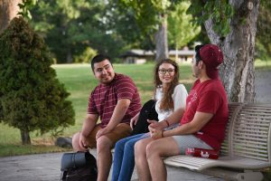 WSU Tri-Cities business student Mario Rodriguez (left) chats with fellow students on the WSU Tri-Cities campus