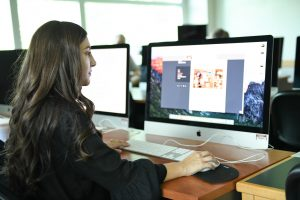 WSU Tri-Cities alumna Dana Dollarhyde works on a graphic design project. She now works as a marketer for Sotheby's International Realty.