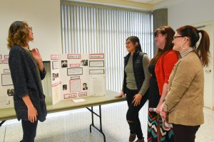 From left: WSU Tri-Cities student Akanna Poor presents on her Title IX project with fellow student Savanna Navarros Kresse to WSU Tri-Cities political science instructor Katie Banks and Tracey Hanshew, clinical assistant professor of history.
