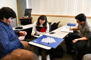 Students in a WSU Tri-Cities English course play a game they are not familiar with, providing an extra challenge when rewriting instructions for the game