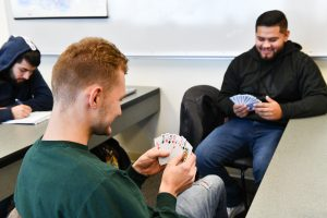 Students in an English course play a game, identifying key instructions that will be more easily translated into other languages.