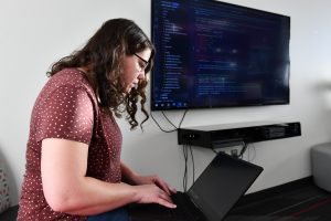 WSU Tri-Cities computer science student KJ Galvan works on a project while at school