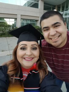 WSU Tri-Cities business student Mario Rodriguez (right) poses for a photo with his mother Maria Luisa Rodriguez who graduated from WSU Tri-Cities last spring with a degree in business.