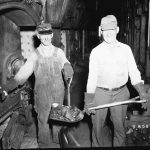 coal workers loading furnaces