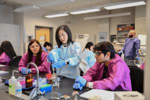 Biology undergraduate students working in lab