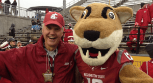 WSU alumnus Brad Fisher and Butch T. Cougar at a WSU football game
