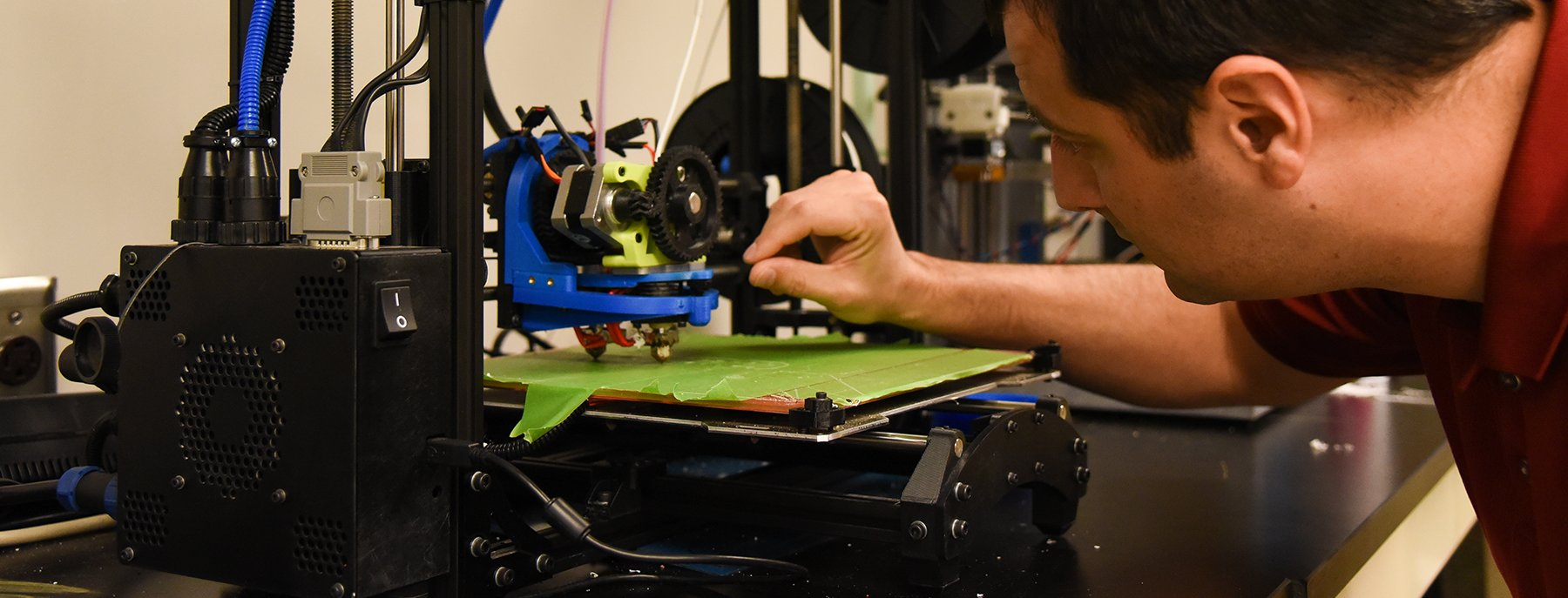 student working with a 3-D printer
