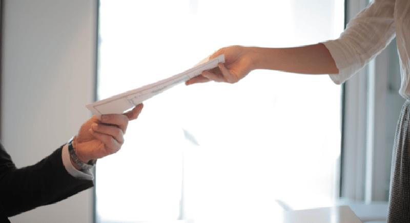 Individuals exchange a resume