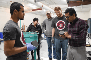 Group of civil engineering students working on cement project