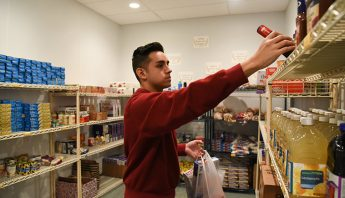 Student Robert Tapia shops in the WSU Tri-Cities Cougar Cupboard.