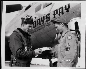 Day's Pay Pilot Arlys Wineinger talks with Ground Crew Chief Salvadore Leto