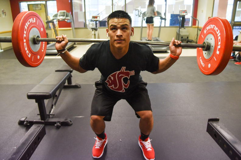 Free-weight exercise among many opportunities available in the newly expanded WSU Tri-Cities' fitness facility