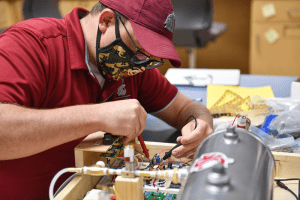 engineering student working on a prototype of a ventilator