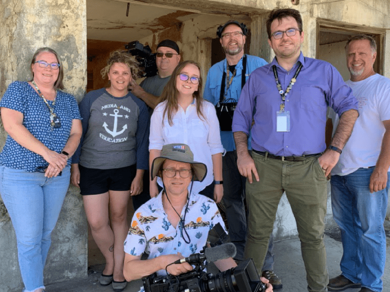 """Robert Franklin (second from right), assistant director of the WSU Tri-Cities Hanford History Project and teaching assistant professor of history, poses for a photo at the Hanford Nuclear Reservation with the film crew and talent for the Daytime Emmy-nominated film """"The Manhattan Project Electronic Field Trip."""""""