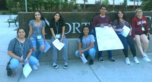 Maria Yepez Perez with a group of GEAR UP students at WSU Pullman