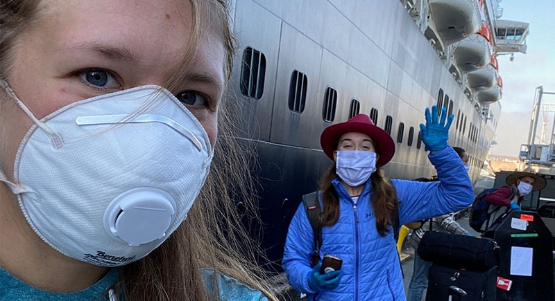Mariah Brush and a friend outside of a cruise ship amid COVID-19.