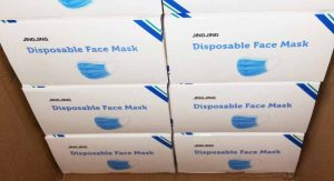 Boxes of disposable face masks donated by Lamb Weston