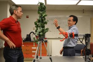 Professor Changki Mo working on apple-picking robot