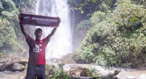 Nikita Fisenko poses with a WSU banner while studying abroad in Costa Rica as part of a medical translation program. He hopes to serve abroad as a nursing missionary, putting his Spanish language fluency to use.