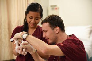 Nikita Fisenko and classmate in a nursing class