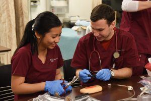 Nikita Fisenko works with a classmate in a nursing course