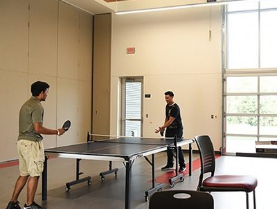 SUB 120S, students playing ping pong