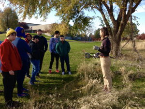 Visiting scholar Sarah Kavage talks to students about a recent art project she completed that involved vegetation braiding. The students then had the chance to try out the technique for themselves.