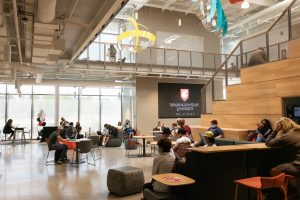 Students study in the atrium of Collaboration Hall at WSU Tri-Cities