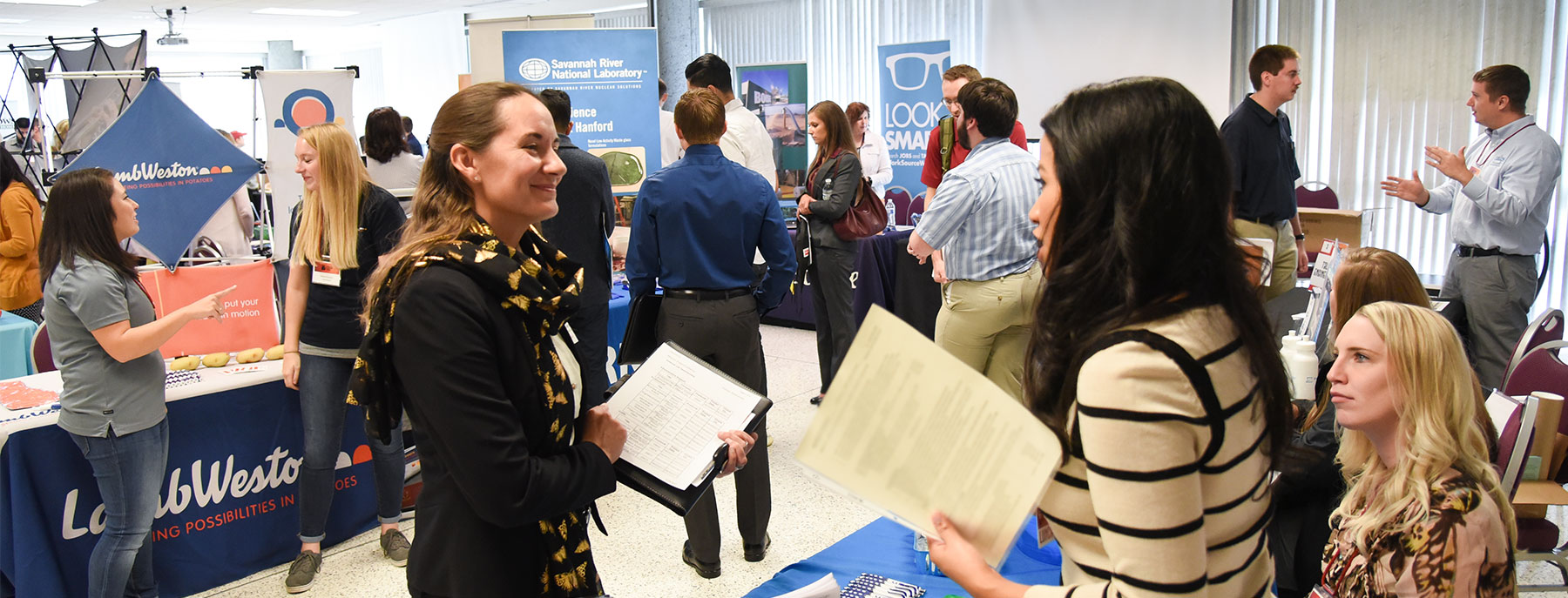 students speaking with potential employers