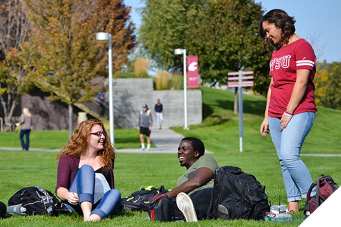 students hanging out in the campus courtyard
